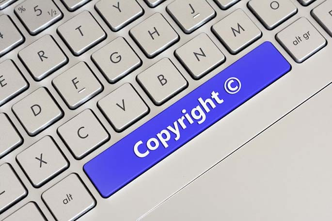 Picture of keyboard with copyright spacebar to accompany blog post about online intellectual property law